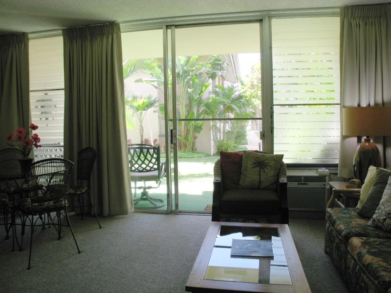 Sliding glass door exit to garden view lanai
