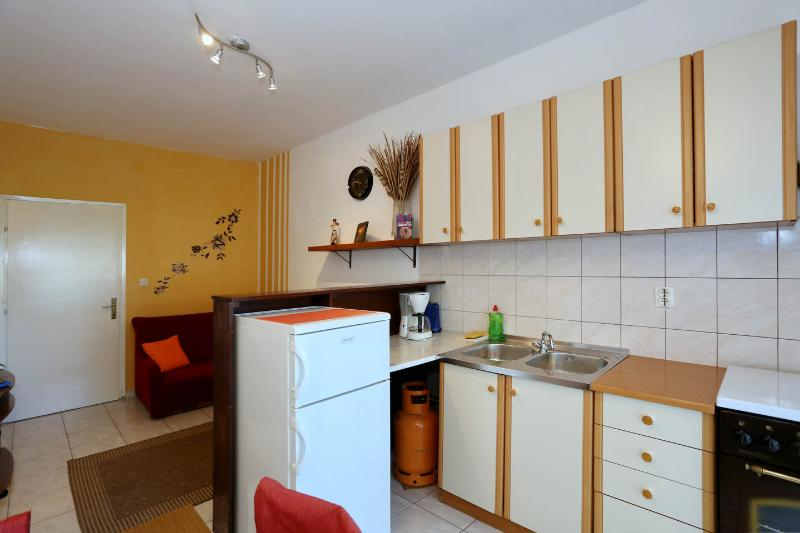 Kitchen features coffee maker and kettle