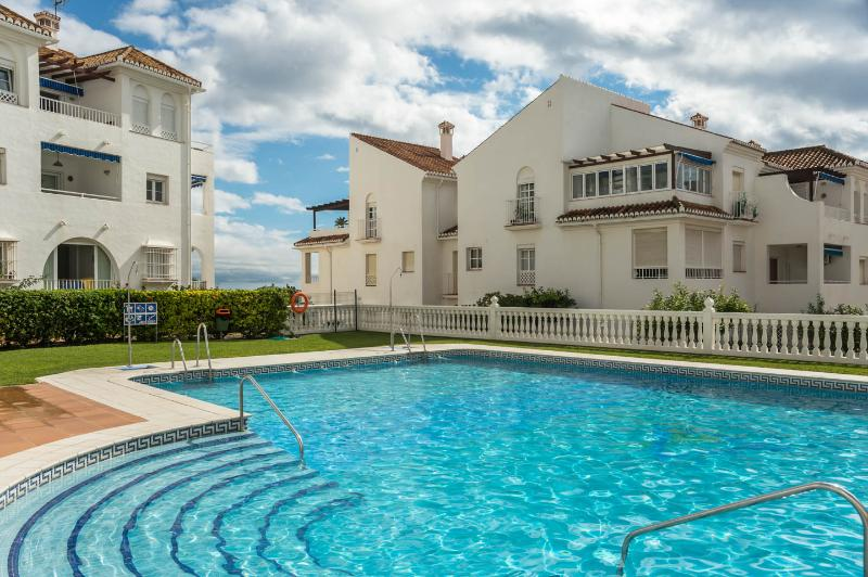 2 bedroom first floor apartment with communal pool and garden area