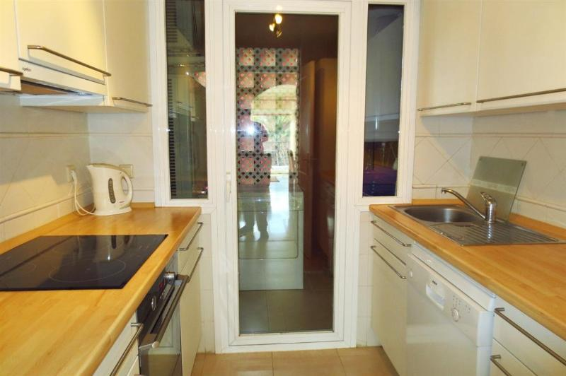 Fully fitted kitchen leading to the utility room