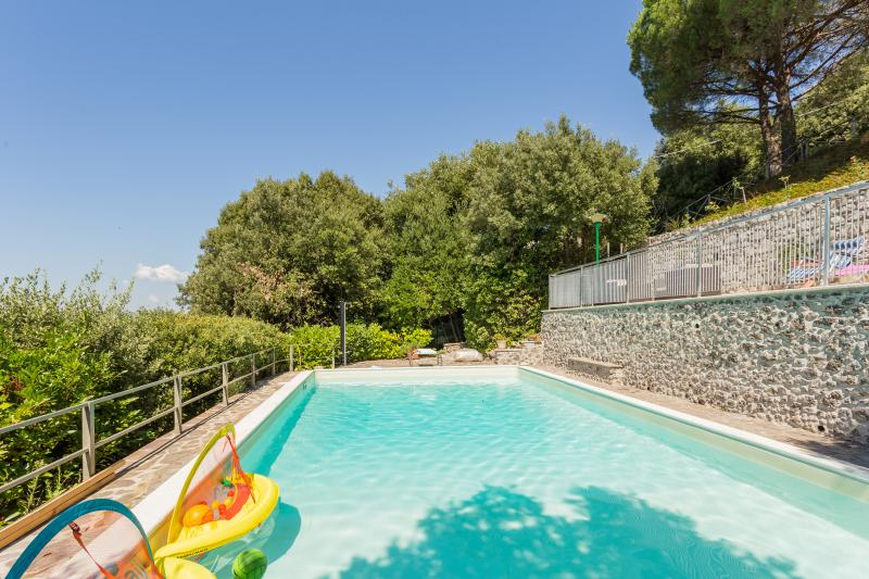 Large outdoor swimming pool with many selections of pool games