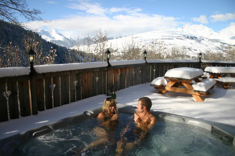 Outdoor hot tub for 8 persons on huge sun deck