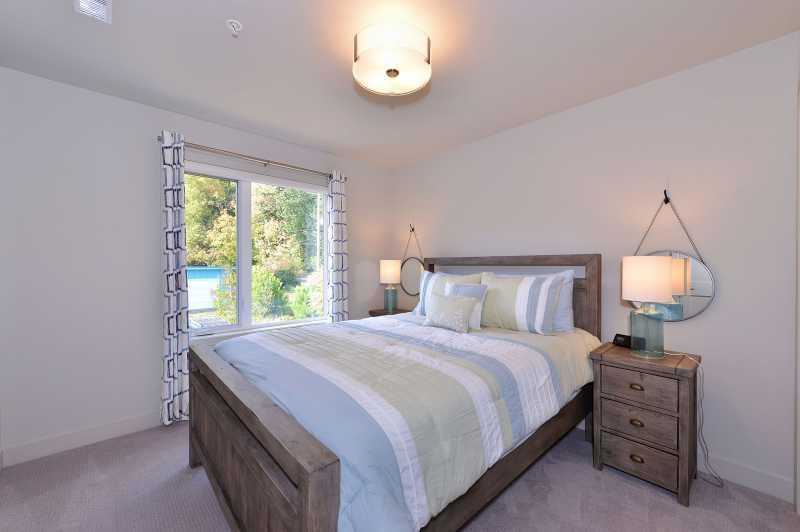 Serene second bedroom with Queen size bed.