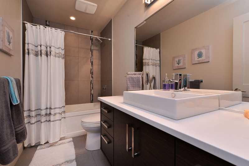 Main bathroom with tub and shower combination.