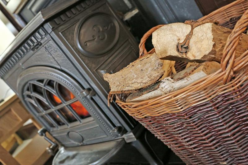 The woodburning stove provides a relaxing cosy ambiance