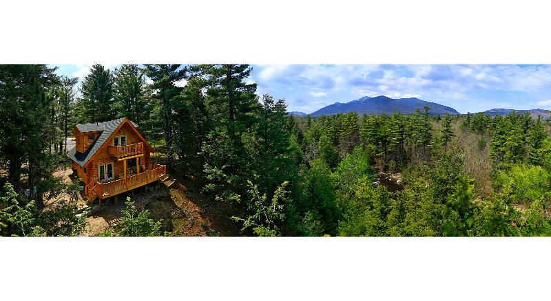 Treetop panorama over house and Whiteface Mt range 180 degree aerial panorama