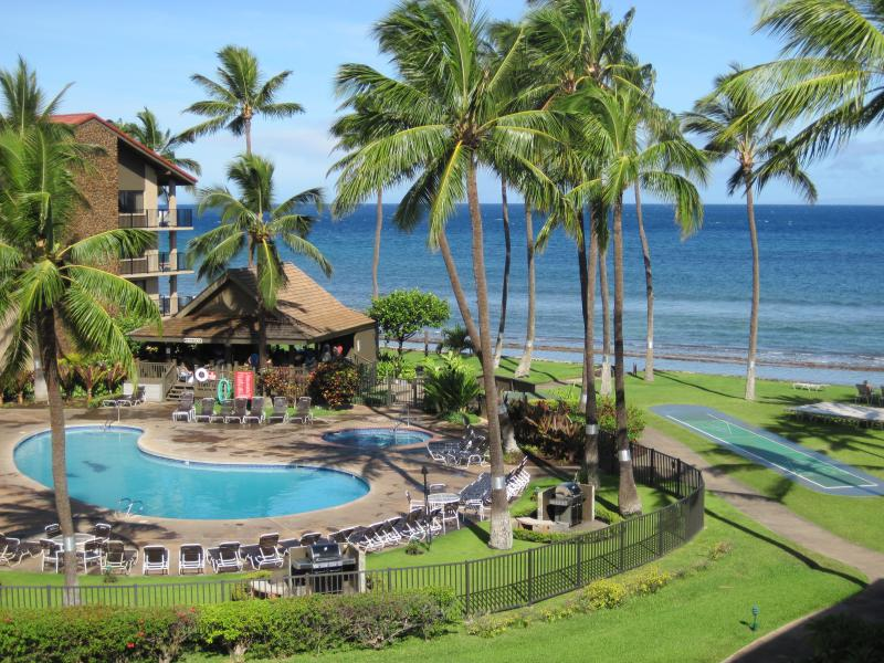 Hear the ocean waves as you overlook the beautiful resort pools and grounds.