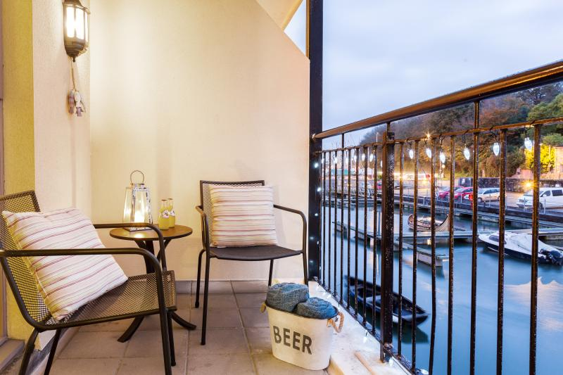 The balcony overlooking the quayside is perfect for evening drinks or soaking up the sun.