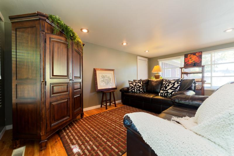Living room,including flat big screen TV, DVD player, extra soft leather sofa & love seat & pillows