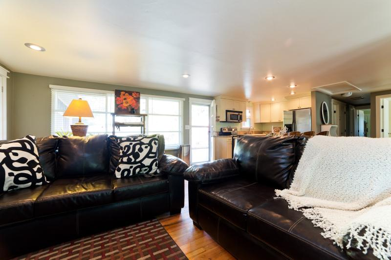 Bright and comfortable living room open to the kitchen and dinning- lovely ranch style.