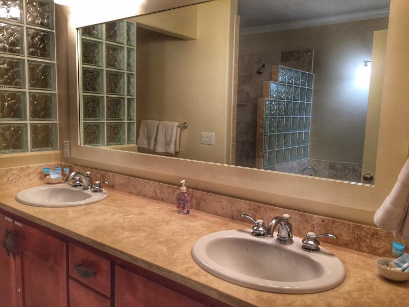 Master bathroom has double vanities