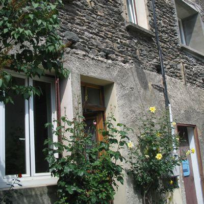 Lovely stone town house located in a quiet side street a minute from all amenities.