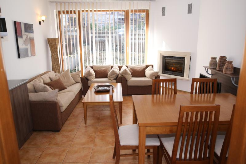 Large spacious living area, relax with a good film in front of the log fire.  DVD, Sat TV & Wifi
