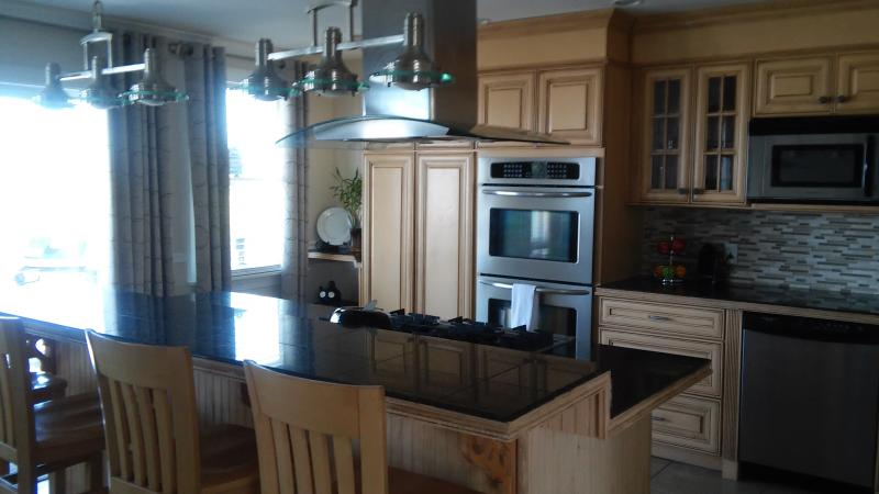 Second floor kitchen with double oven two dishwashers, private deck overlooking the ocean