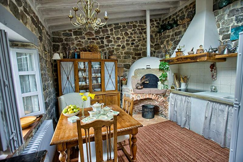 Kitchen with old wood-fired oven for bread-making...