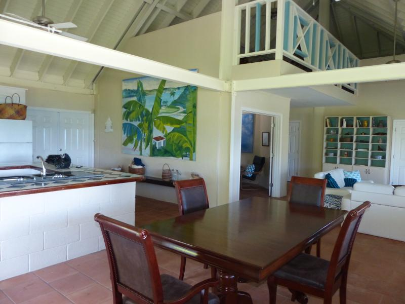 the great room, huge vaulted ceilings, fans, screens on all the doors to let in breezes.