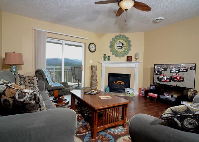 Large Flat Screen TV and Gas Fireplace in Living Room