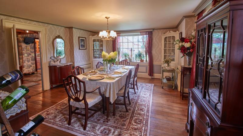 Formal dining room with bay window facing entry walk.