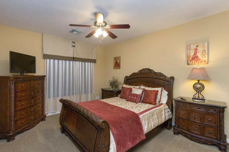 Queen size bedroom upstairs with its own TV