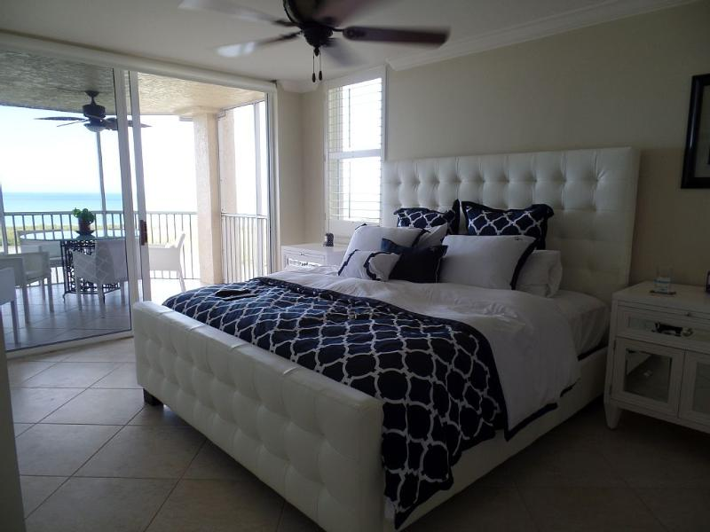 Master BR has been decorated with a contemporary tufted bed, plenty of drawer space and fine linens