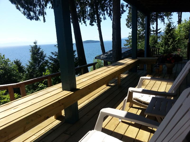 Large private covered deck with tons of room for lounging and dining