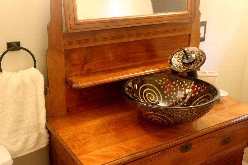 re-purposed vanity with glass sink