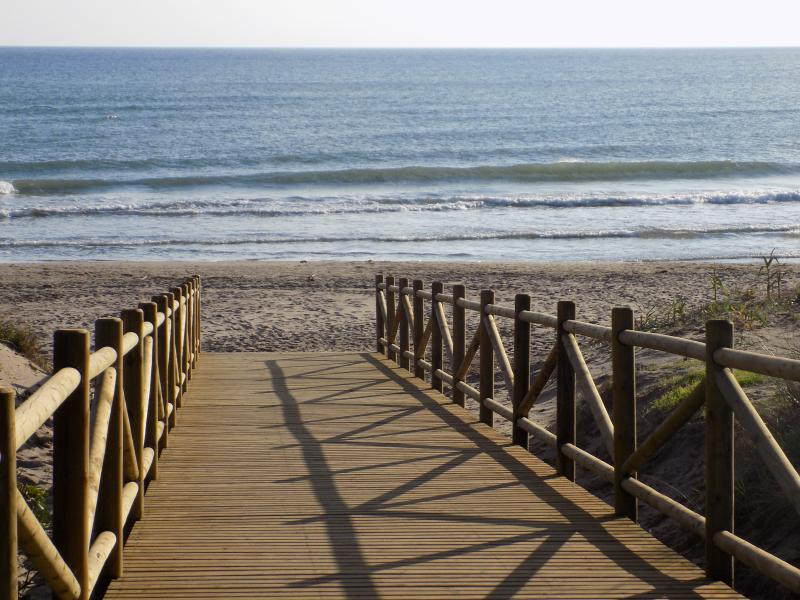 Boardwalk access to Carib Playa sandy beach 5 minutes walk