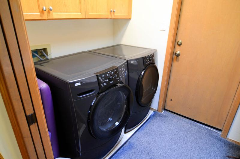 High efficiency washer-dryer in the laundry room. (Door to garage.)
