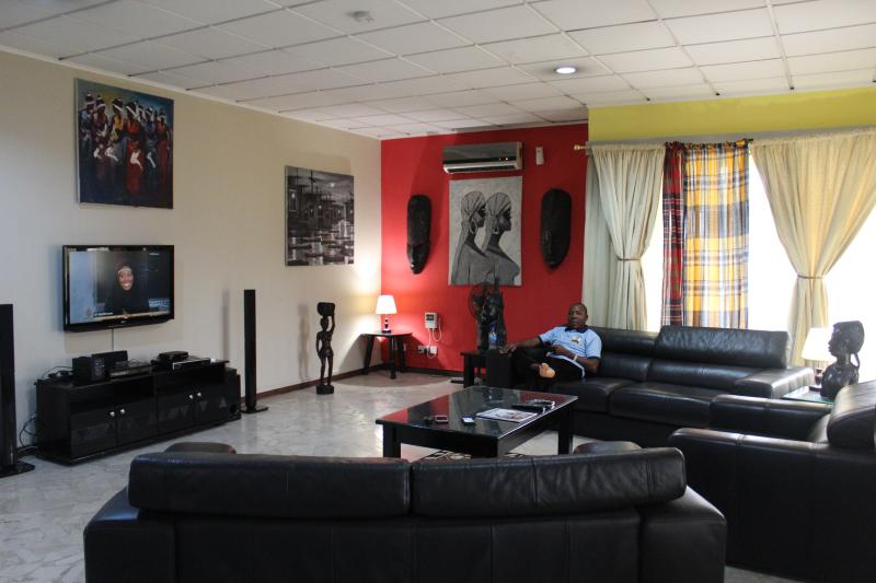 Exquisite lounge area with the best of African art decor