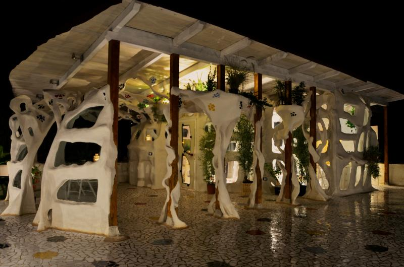 A large exclusive terrace with the liveable sculpture at night time