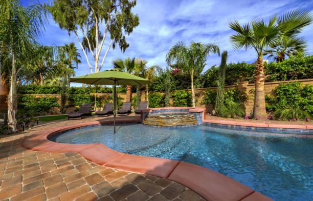 Gorgeous Pool, Spa, Tanning Ledge and Water Feature.