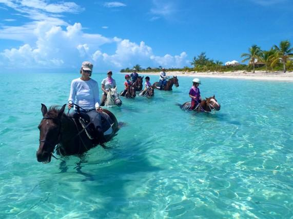 ...or horseback ride through the crystal clear waters.