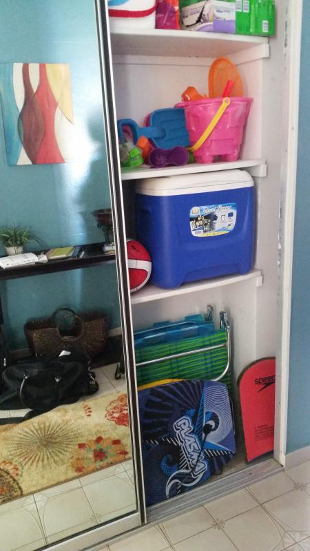 beach gear in entryway closet