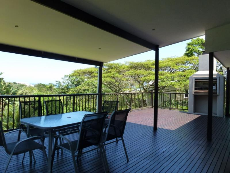 Relax on the deck with a built in braai in tranquil surroundings