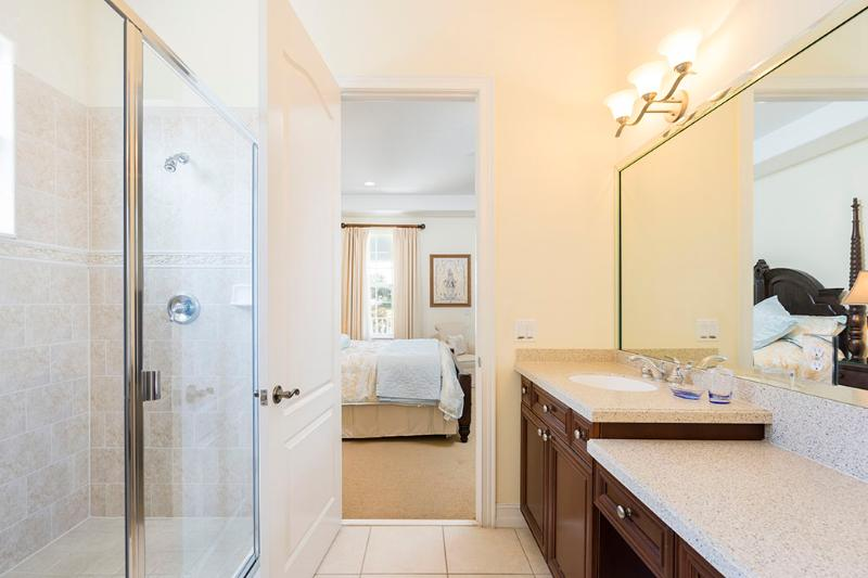Bathroom ensuite with twin vanities and double walk in shower.