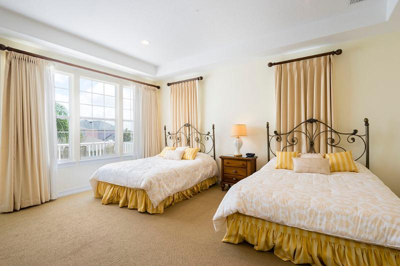 Two queen beds upstairs with access to balcony.  Walk in wardrobe.
