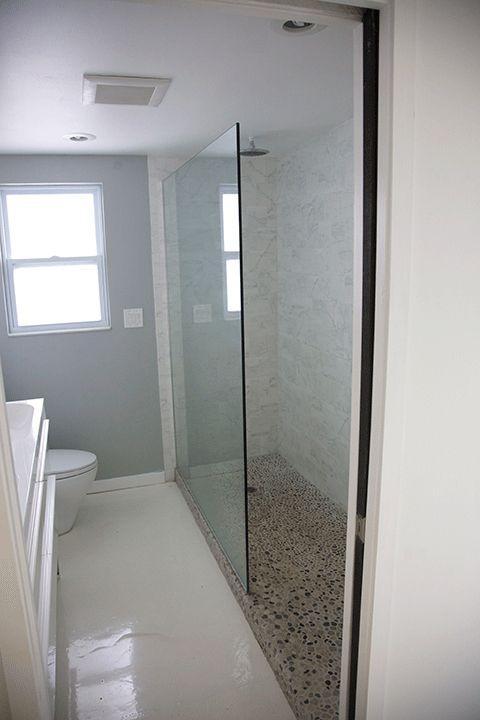 Pluie douche marbre et galets plancher de verre.. .que vous rendre confortable.