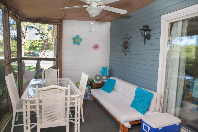 This quiet screened porch is a special highlight for boring coffee or relaxing after the beach