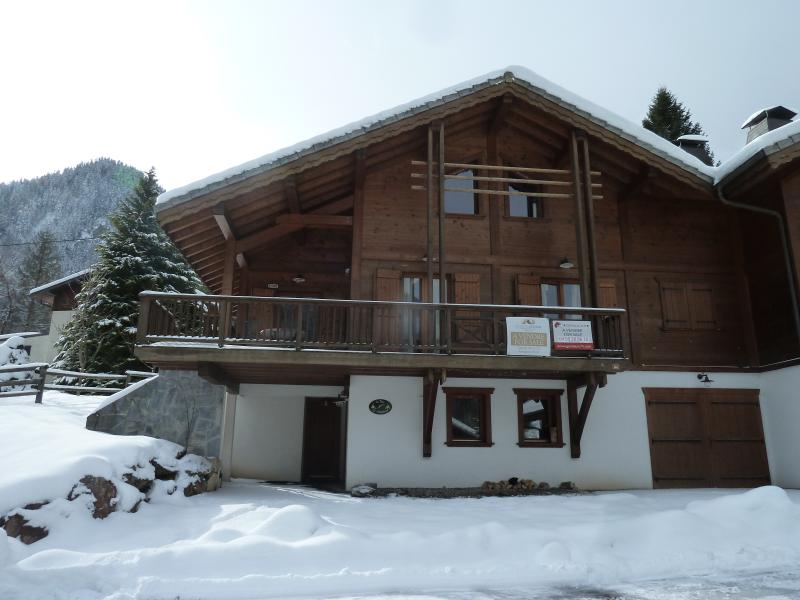 Front of chalet with full balcony and views over the valley and mountains