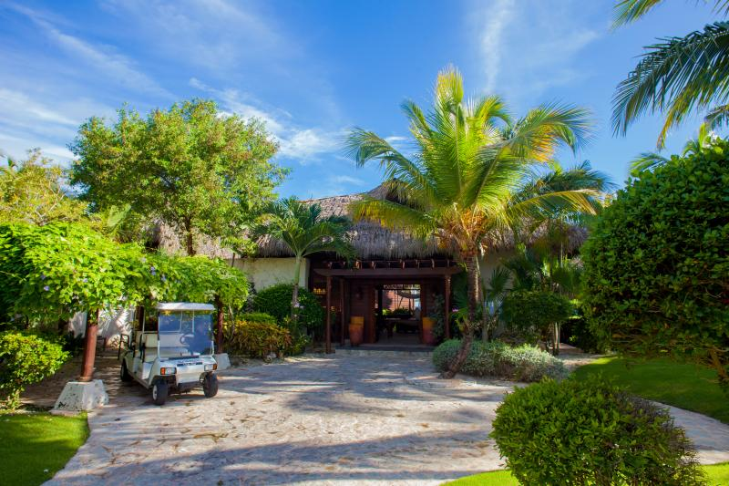 Entrance to villa with the included 6 seater golf cart