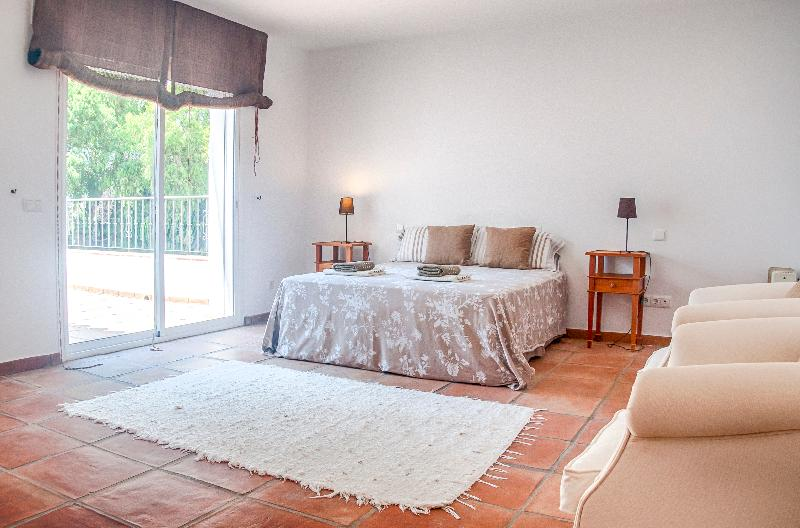 Master bedroom with large private terrace and sofa