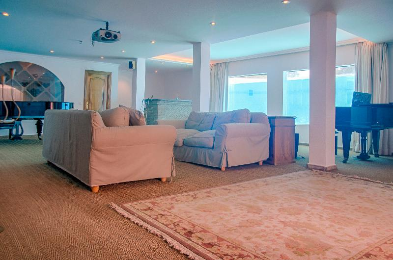 Entertainment room with aquarium underwater windows to pool, independent kitchen and home cinema