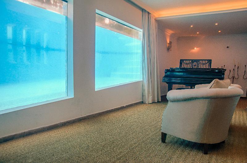 Aquarium windows to the pool in entertainment room
