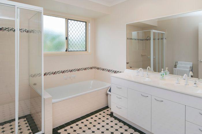 Family bathroom, with shower and bath. Toilet separate