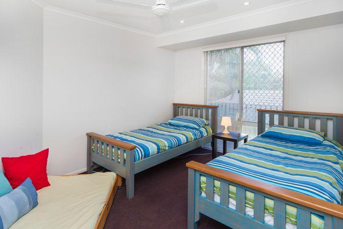 3rd bedroom with three single beds