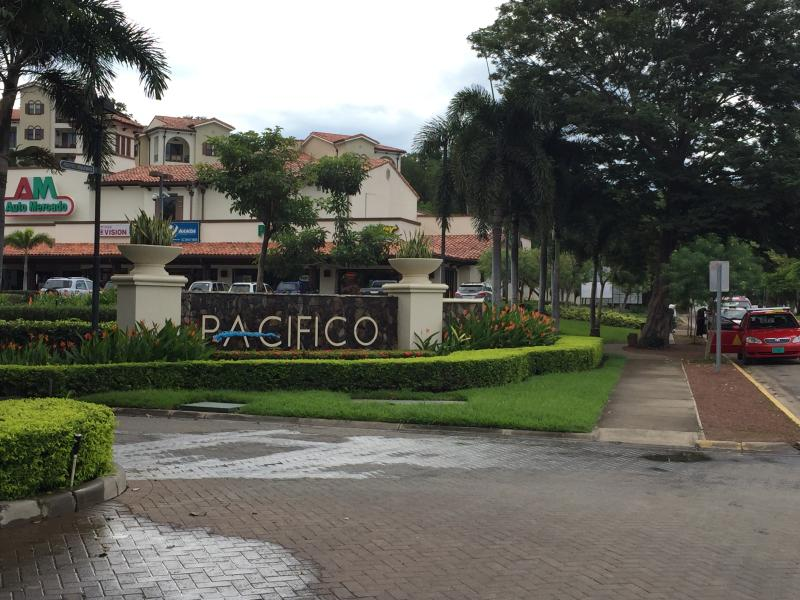 Pacifico resort entrance on main street has taxi stand & grocery store
