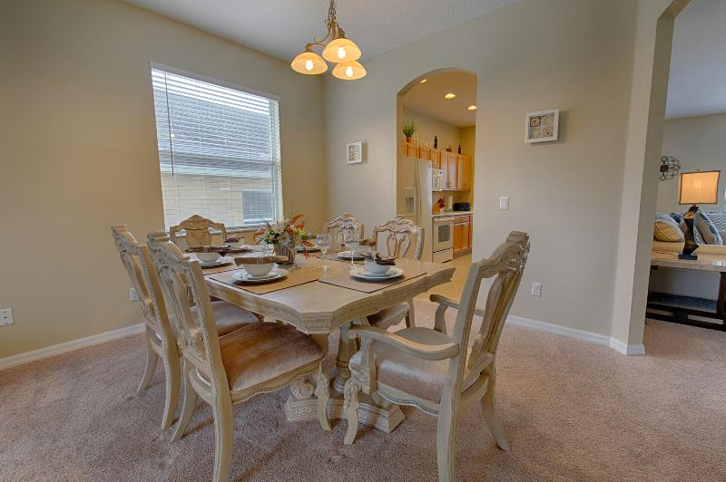 Dining room with large table 4 chairs and 2 carver chairs