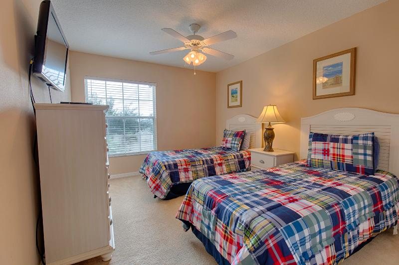 Twin bedroom with 32'flat screen TV,ceiling fan and large closet.