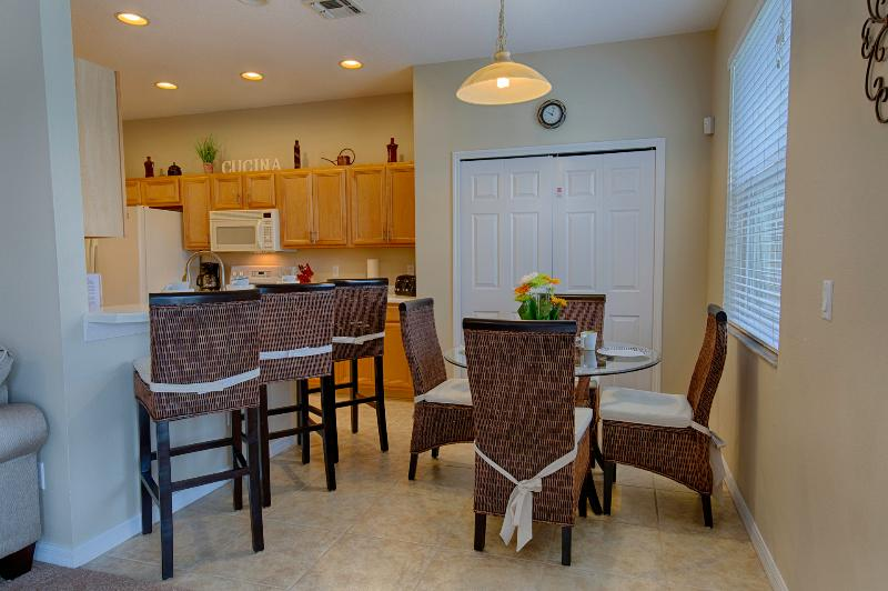 Breakfast nook with table and 4 chairs plus 4 barstools @breakfast bar