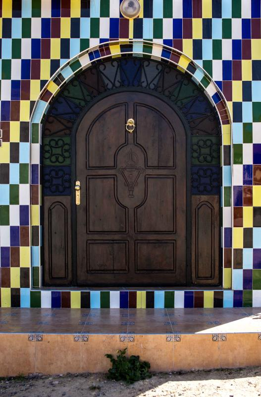 Unique, detailed front door.The light shines through the coloured panels creating a wonderful light!